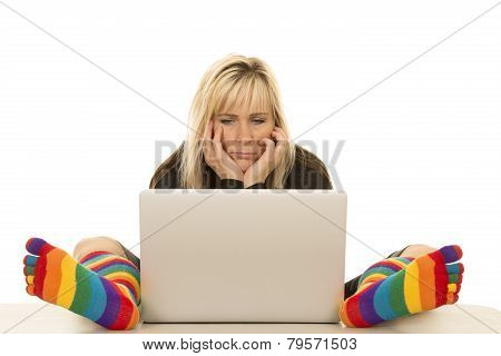 Woman Colored Socks Sit By Computer Hands On Face