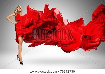 Blond Woman In Beautiful Blown Red Dress