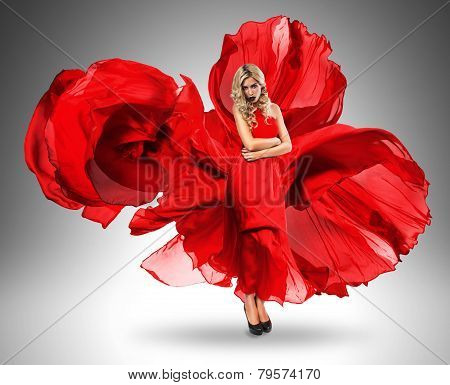 Sexy Woman In Blown Large Red Dress