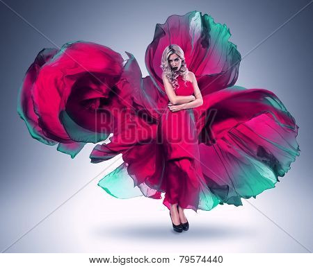 Woman In Blown Pink And Green Dress