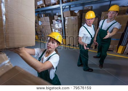 Young Woman Working In Storehouse