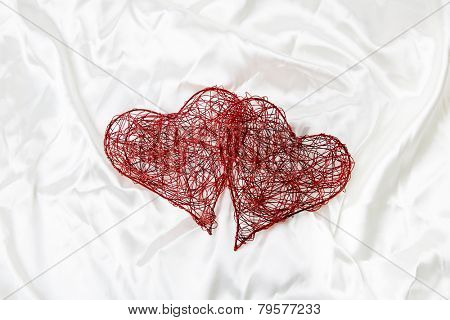 Valentine day red hearts on satin background