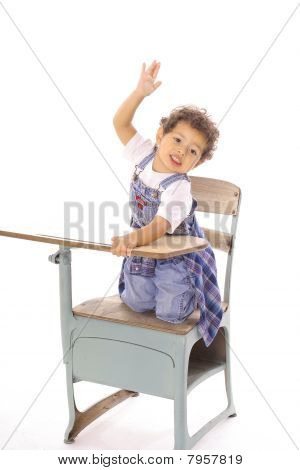 child raising hand in desk isolated