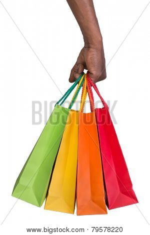 Male hand holding shopping bags isolated on white background