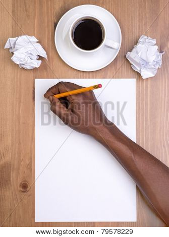 Man writing on a blank piece of paper