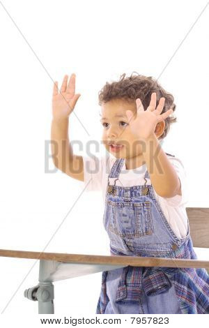 toddler in class with hands up