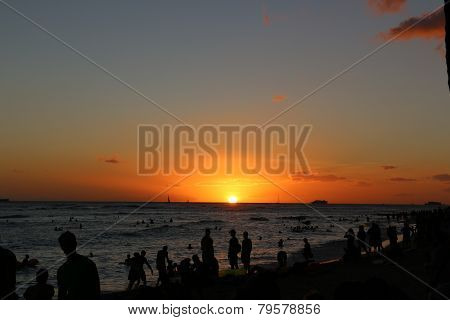 Silhouettes on the beach at Sunset