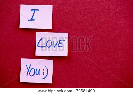 Text I Love You On Yellow Sticky Reminder Note With Textured Backgroud