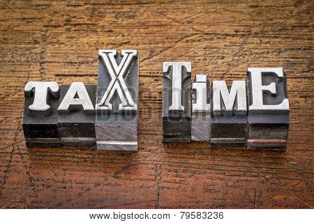 tax time - financial concept - words in mixed vintage metal type printing blocks over grunge wood
