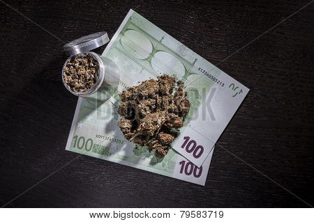 Metal Grinder With Marijuana And Money