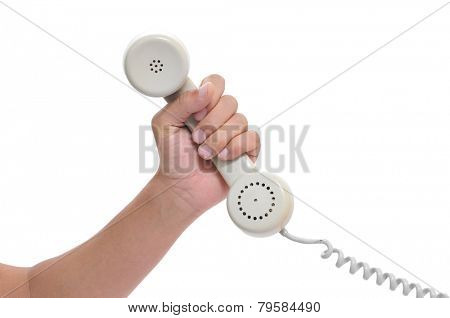 closeup of the hand of a young man holding the handset of a telephone, on a white background