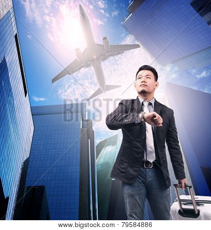 Business Man And Belonging  Luggage Standing Against Urban Building And Air Plane Flying Above Use F