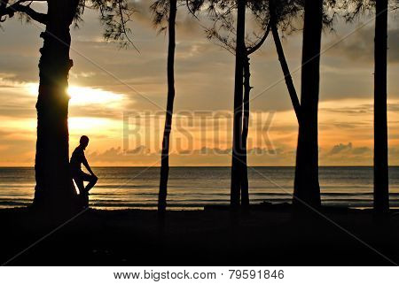 Sillhouette Of A Young Girl Watching Beautiful Sunset