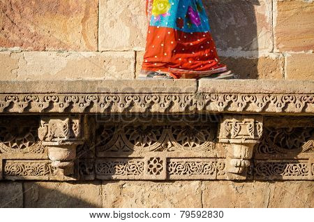Indian Woman Walking On Beautiful Border Patterns & Designs Engraved