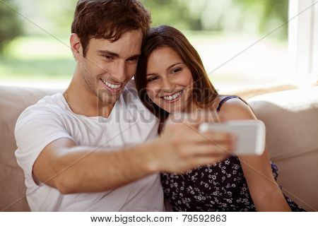 Young Couple Taking A Selfie At Home