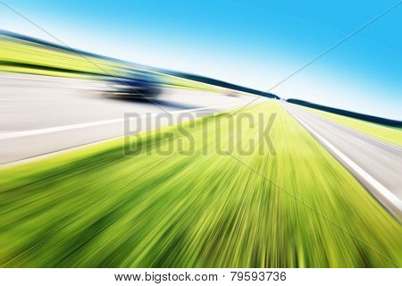 Motion blurred car on highway.Roadside view.