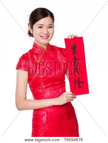 Woman with traditional cheongsam and holding Fai Chun, phrase meaning is business prospers