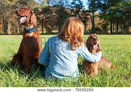 Woman sitting with dogs
