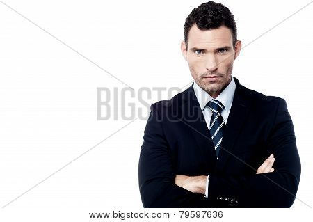 Angry Businessman With Crossed Arms