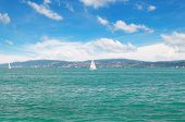 picture of sailing vessel  - seascape with turquoise waters and sailing vessel