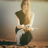 picture of gothic  - unusual gothic girl with long red hair and ground in palms - JPG