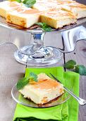 picture of cheesecake  - Squares of cheesecake with syrup  on plate - JPG
