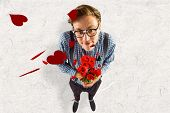 picture of bunch roses  - Geeky hipster holding a bunch of roses against parchment - JPG
