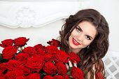 image of fascinator  - Beautiful smiling woman with makeup red roses bouquet of flowers - JPG