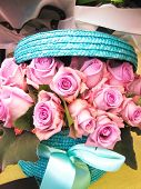 stock photo of gift basket  - Beautiful pink rose flowers bunch in a basket