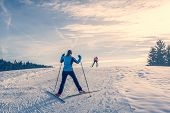 pic of ascending  - Cross country skier ascending a steep slope - JPG