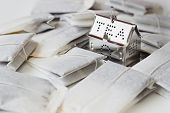 foto of tea bag  - tea strainer and tea bags on the table selective focus - JPG