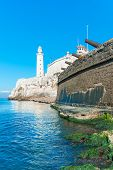 stock photo of el morro castle  - The fortress of El Morro in Havana with an old spanish cannons battery on the foreground - JPG