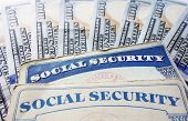 picture of social-security  - Social Security cards and hundred dollar bills - JPG