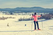 stock photo of ascending  - Woman cross country skiing - JPG