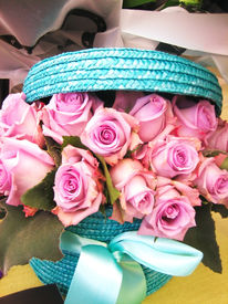 stock photo of gift basket  - Beautiful pink rose flowers bunch in a basket  - JPG