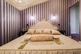 foto of enormous  - View of enormous bed inside baroque bedroom - JPG