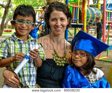 Kindergarten graduation success of mixed adopted family