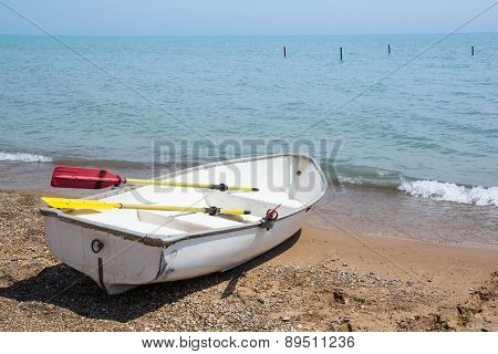 Row boat on the shores of Lake Michigan