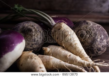 Root Vegetables From The Garden On A Brown Background