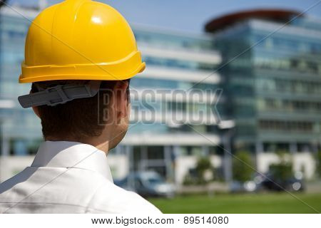 Architect in hardhat at construction site