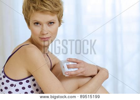 young woman sitting in bed