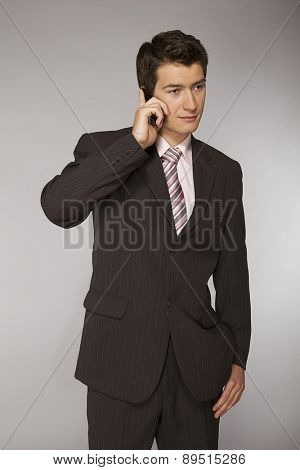 Young caucasian businessman talking on phone