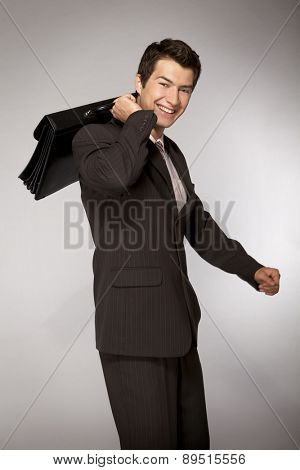 Young caucasian businessman with briefcase
