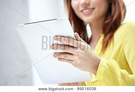 people, technology and internet concept - close up of female hands with tablet pc