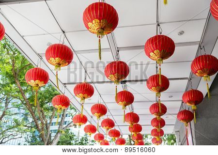 asia, tradition and holidays concept - ceiling decorated with hanging chinese lanterns