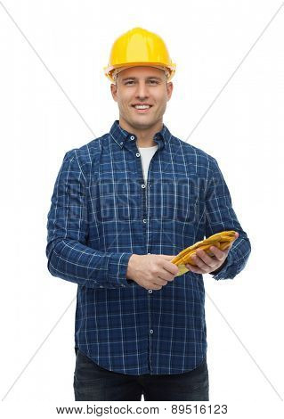 repair, building, construction and maintenance concept - smiling man in helmet with gloves