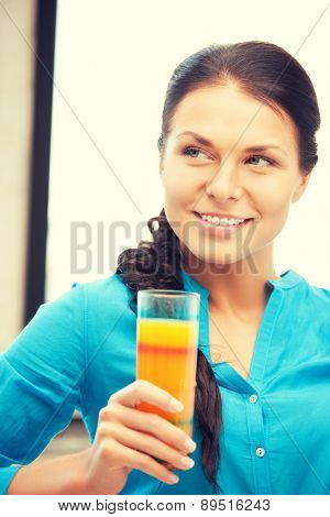 picture of beautiful woman with glass of juice