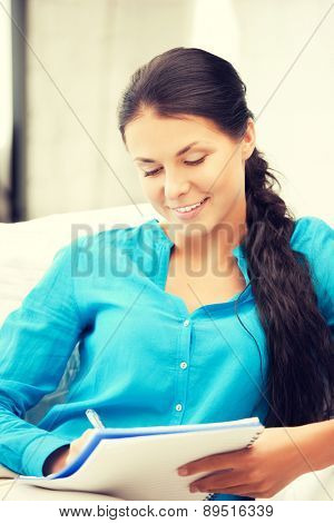 picture of happy woman with big notepad