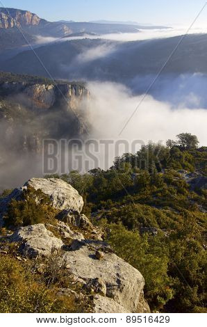 mountain landscape with fog in Vilanova de Meia, Spain