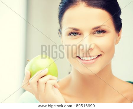 picture of beautiful woman in the with an apple..